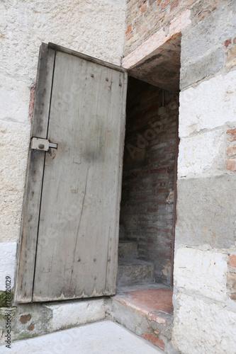 old wooden door of bell tower Poster