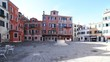 Quadro wide square in Venice Italy and the ancient well