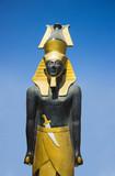 Stone pharaoh tutankhamen on dark background