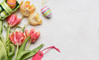 Easter background with fresh tulips, decor eggs and tag, top view, place for text