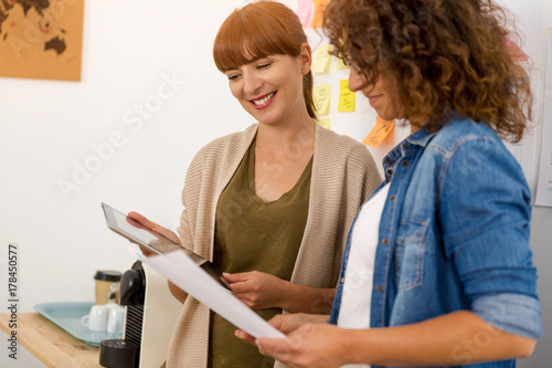 Two businesswoman working together Poster