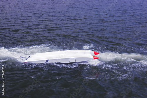 Papiers peints Nautique motorise An offshore boat upside down and puleed by a vessel in the sea