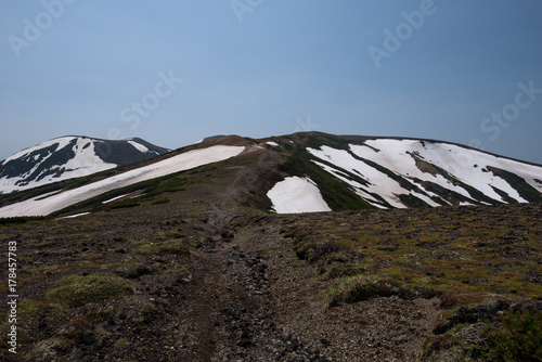 Foto op Canvas Grijze traf. Rocky hiking trail over the mountain ranges of Daisetsuzan National Park, Hokkaido, Japan