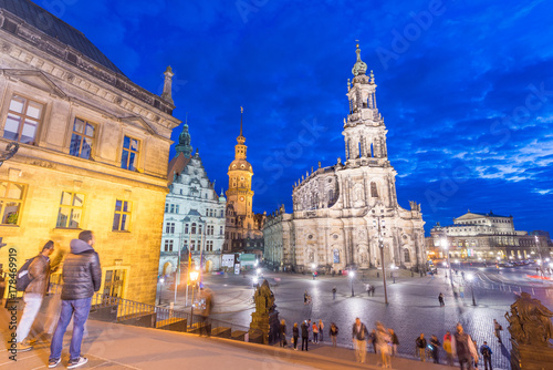 Papiers peints Bleu fonce DRESDEN, GERMANY - JULY 15, 2016: Tourists along old city streets at night. Dresden attracts 5 million tourists annually