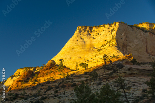 Fotobehang Nachtblauw Layered Sandstone Cliffs of East Zion at the Sun Sets