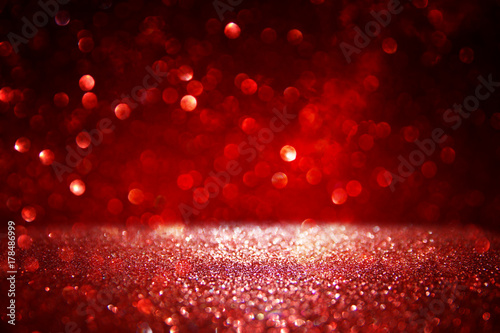 Red glitter vintage lights background. defocused. Poster
