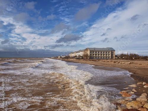 Fotobehang Diepbruine Beautiful sky and the sea with rolling waves (Saki, Crimea ).