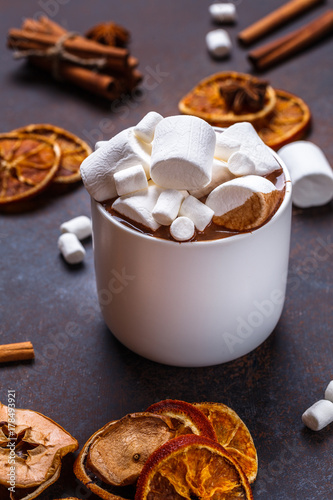 Foto op Aluminium Milkshake Christmas cookies in a white wooden box with hot chocolate and marshmelow, on a dark background.