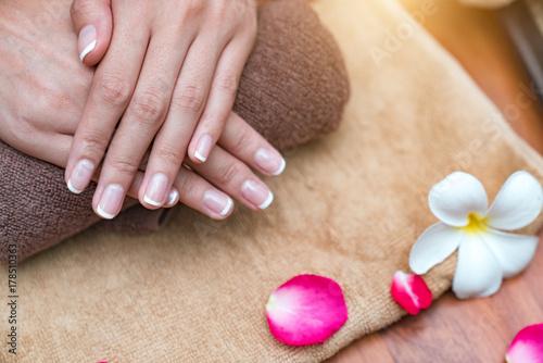 Aluminium Manicure Beautiful woman hands and flowers.