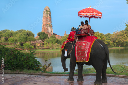 Fotobehang Thailand Tourists lover on an ride elephant tour of the ancient city sunset ,ayutthaya, thailand