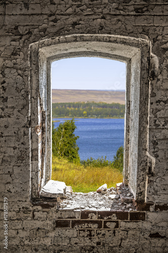 A view from a window hole of an old dilapidated abandoned house. - 178517579