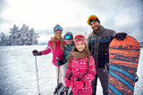 family enjoying winter sports and vacation on snow in mountains
