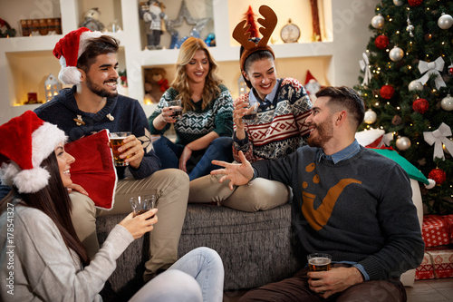 Group of friends having fun in Christmas eve