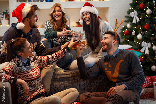 Young people toasting in Christmas eve