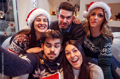 Cheerful friends make funny face in New Year's eve