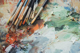 Colorful artist brushes and paint.
