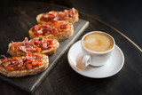 hot coffee cup with bruschetta - 178549549