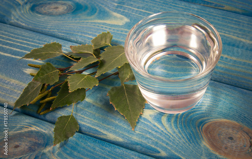 Fotobehang Sap A glass of birch juice on wooden background