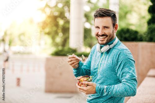 Man is eating vegetable salad