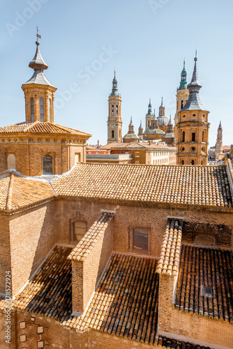Top view on the roofs and spires of the churches in the center of Zaragoza city during the sunny day in Spain