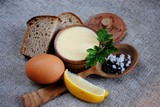 Mayonnaise sauce and ingredients on white wooden table. Top view - 178590191