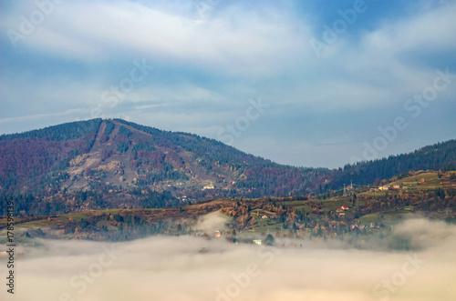 Fotobehang Bleke violet Foggy morning in the Ukrainian Carpathian Mountains in the autumn season
