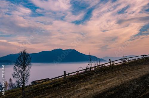 Papiers peints Saumon Foggy morning in the Ukrainian Carpathian Mountains in the autumn season