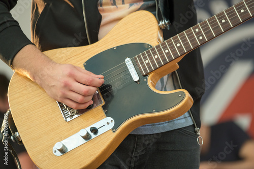 Man playing electric guitar close up Poster