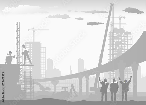 workers build a new overpass in the area of the city in the fog - 178607939