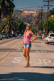 Beautiful girl at the Hollywood district near the Hollywood sign in Los Angeles.