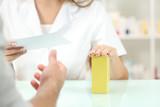 Pharmacist preparing medicine reading recipe - 178622130