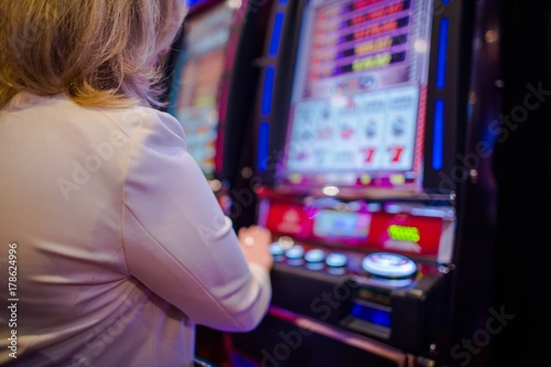 Poster Woman Playing in the Casino