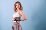Elegant woman holding hand purse wallet - 178630175