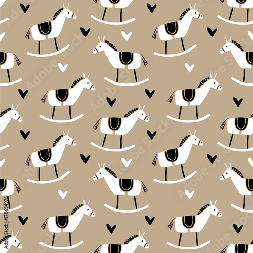 Cotton fabric Cute Christmas seamless pattern with hand drawn wooden horse toys and hearts. Fabric or wrapping paper traditional design. Vector illustration background.