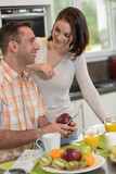 Young couple in love prepare healthy breakfast in the kitchen