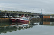Fishing boats in a harbor. Trawler after fishing. Fishing industry, fishery. Commercial ship for seafoods in Dieppe, Normandy