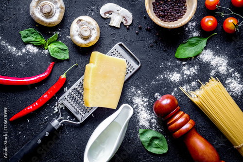 ingredients for cooking paste on dark background top view