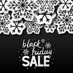 Black friday background with paper snowflakes