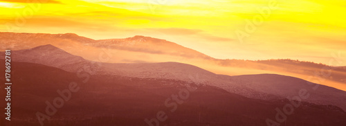 Fotobehang Geel Beautiful, colorful autumn sunrise over the mountains in Norway. Abstract, colorful look.