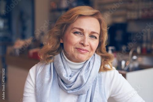 Happy mature woman looking at camera