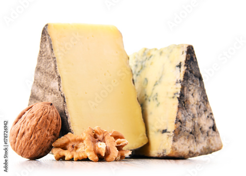 Two pieces of cheese isolated in white background