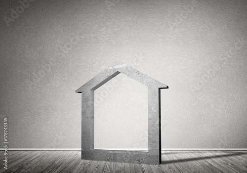 Conceptual background image of concrete home sign in room with wooden floor