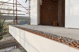 Installation of outer coat insulating on a residential home - 178746713