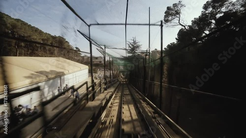 Timelapse shot of funicular train moving on railway. Barcelona, Spain.