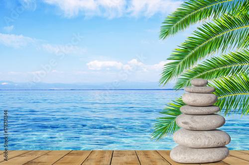 Fotobehang Zen Arrangement of balance pebble stone on wooden table like symbol of spa harmony