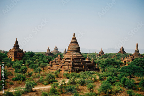 View across pagodas towards Thatbinnyu Temple Pagoda in Bagan My Poster