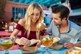 romantic couple eating street tacos at outdoor mexican restaurant - 178759300