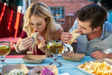 romantic couple eating street tacos at outdoor mexican restaurant - 178759335