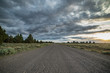 Dramatic empty gravel road into the unknown