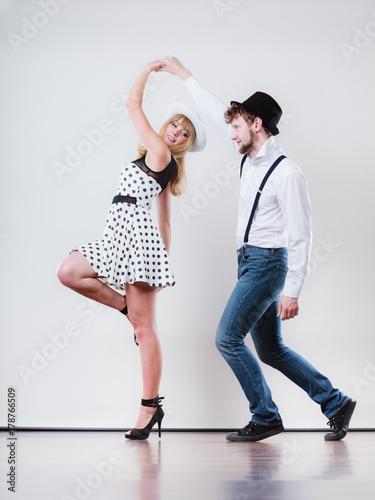Young happy couple dancing